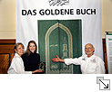 Annette and Rüdiger Nehberg presenting THE GOLDEN BOOK with Stefanie Silber who designed the book